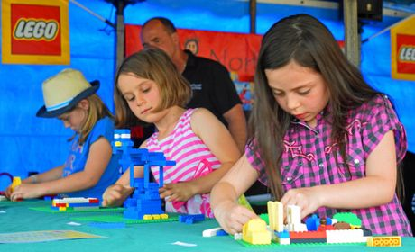 PICTURE OF CONCENTRATION: Georgina Constable, 7, left, halfway through building her winning entry of a bird in the North Coast National Junior Lego Finals.