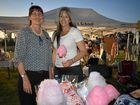 Angela Brennan and Tia Bentley serving up fairy floss at the St John's Moonlight Fair on Friday night.