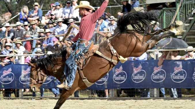 FULL FLIGHT: Millmerran's John McNamee rides POison Arrow in Australian Professional Rodeo Association action.