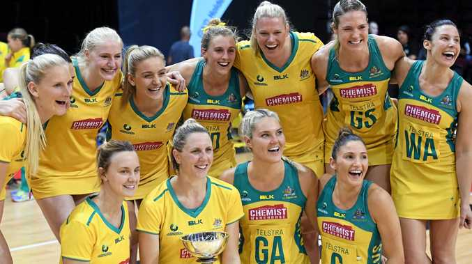 Clare McMeniman holds the trophy as the Australian Diamonds celebrate their series defeat of New Zealand in the Constellation Cup. Many of the same players will be hoping to be in the team for the 2018 Commonwealth Games.