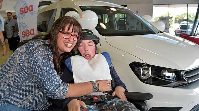 Yoshe Hodgkinson and her son Jakson are happy to get a new van, thanks to 91.9 and Caloundra City Autos.
