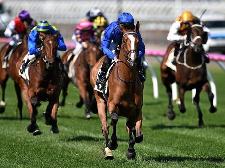 James McDonald (centre blue silks) rides Hartnell to victory in the Turnbull Stakes at Flemington Racecourse in Melbourne, Sunday, Oct. 2, 2016. (AAP Image/Julian Smith) NO ARCHIVING, EDITORIAL USE ONLY