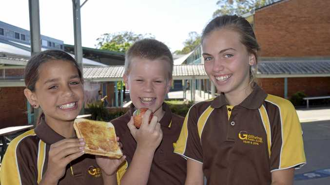 BREAKFAST CLUB: Gillwinga Public School students Nikita Daley, Adam Wright and Jakayla O'Driscoll take advantage of the free Monday breakfast.