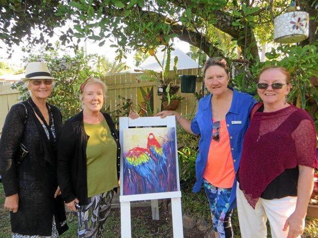 FROM LEFT: Essie Bird, Gwen Smithers, Gayle Robinson and Gail Willmott in Gwen's garden - the artwork was painted by Gwen.