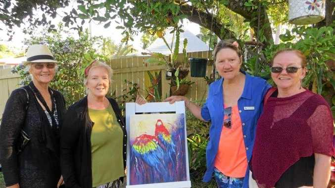 FROM LEFT: Essie Bird, Gwen Smithers, Gayle Robinson and Gail Willmott in Gwen's garden - the artwork was painted by Gwen.