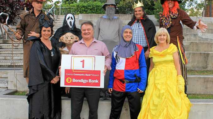 CHRISTMAS AND THE MOVIES: Bendigo Bank's Geoff Edwards with the organising committee trying out some Movie Costumes for the Bendigo Bank Street Parade.