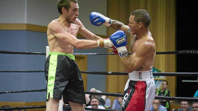 Maks Chylewski (left) and Jamie Hilt trading blows at last yeasr's Fight Against Depression 4 at Oakey Cultural Centre.
