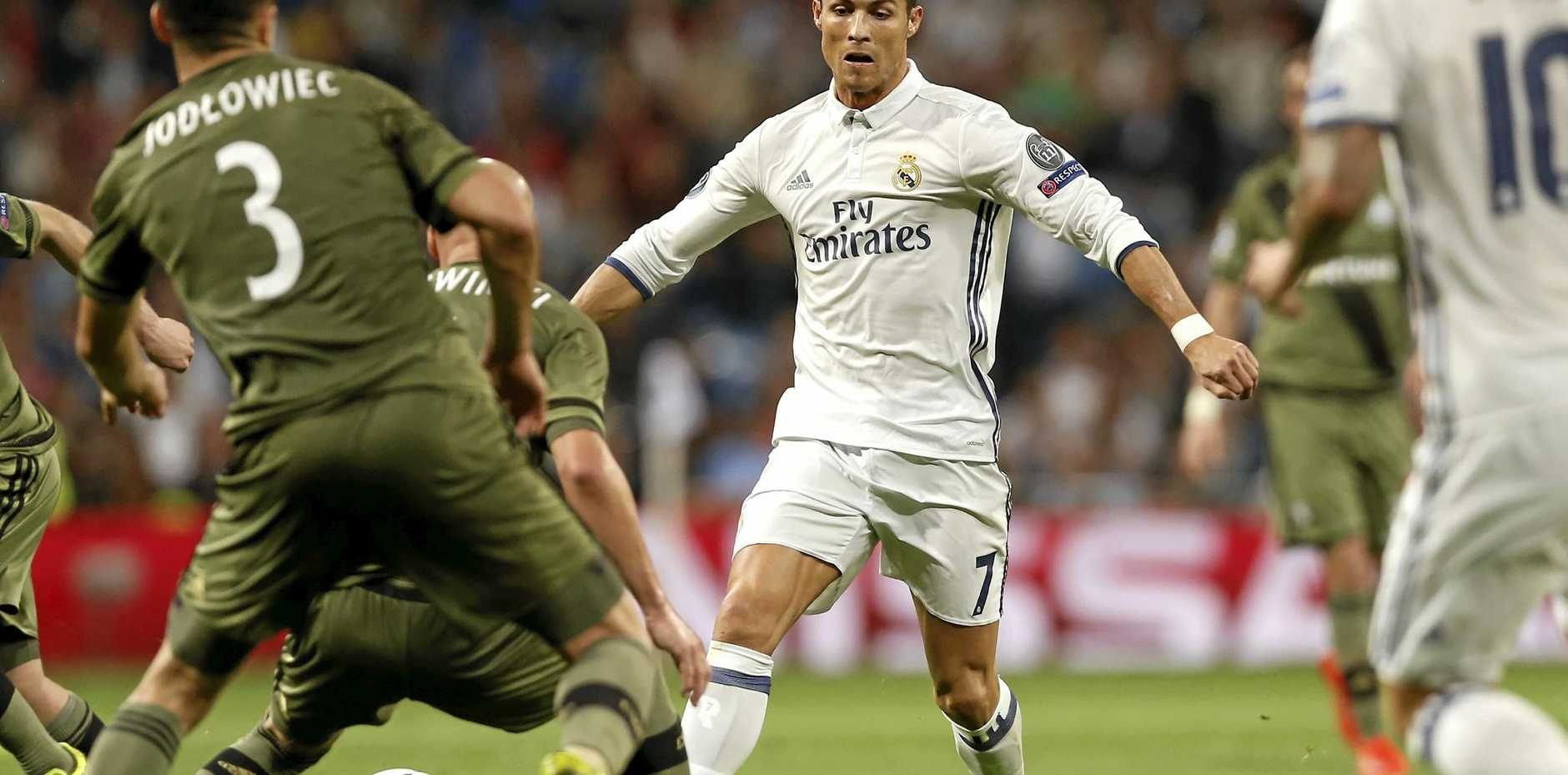 Real Madrid's Cristiano Ronaldo fights for the ball during a Champions League Group F soccer match between against Legia Warsaw at the Santiago Bernabeu stadium in Madrid.