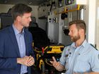 Queensland Minister for Main Roads and Road Safety Mark Bailey speaks about the new ambulance traffic technology with paramedic Chris Randall Day.