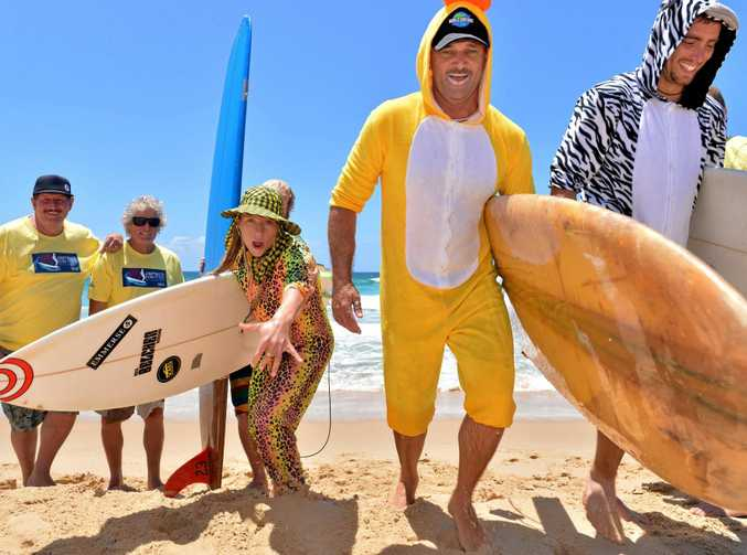 Peter James, Mark Skinner, Anthony Russell, JP Storm, Dave and Taia Beazley on Kawana Beach for a Board Meeting corporate surf contest to aid children with disabilities. There are only spots left for six teams for this year's event on November 12. Photo: John McCutcheon / Sunshine Coast Daily