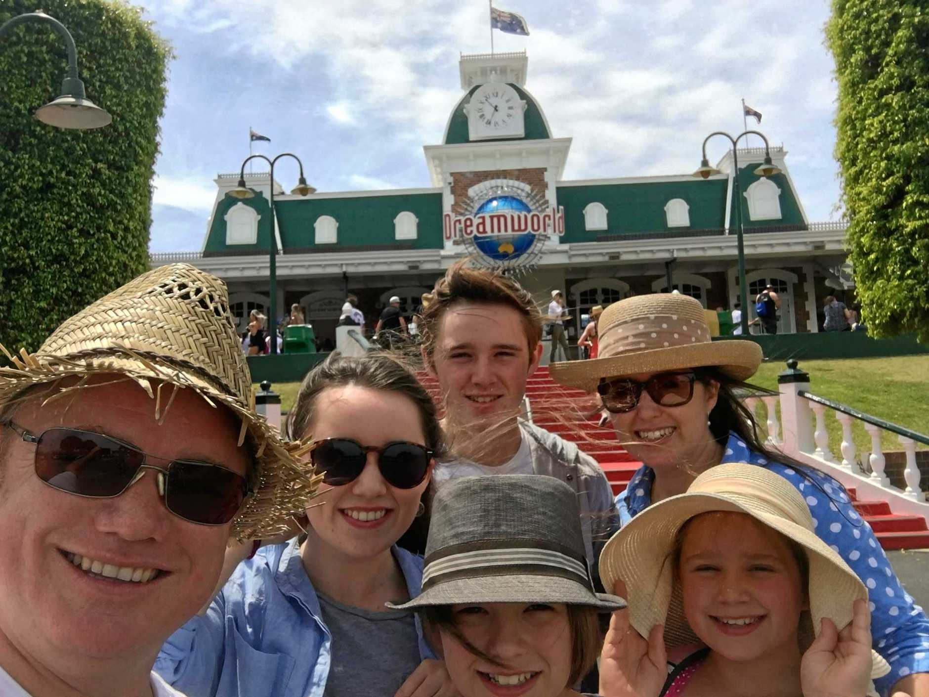 Rebecca Moore (right back) with husband, Tony (left) and children going into Dreamworld