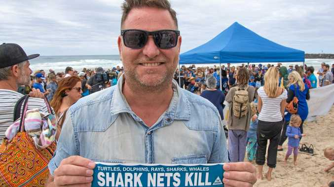 NO NET GAIN: Byron Shire Mayor Simon Richardson makes his opinion clear at last weekend's No Nets Rally and turtle release at Ballina.