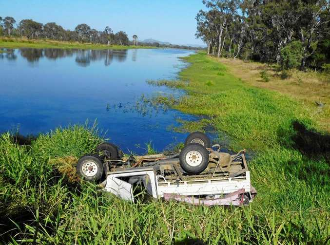 A Toyota Landcruiser partially submerged in water along Nine Mile Rd, Pink Lily.