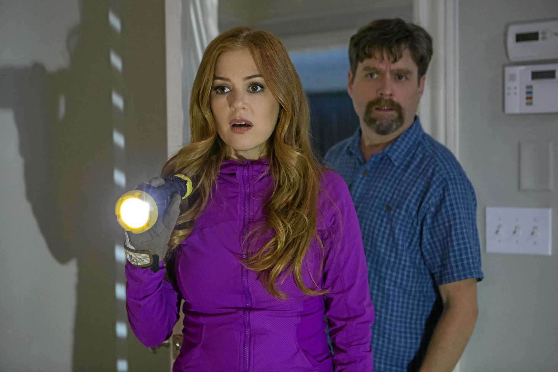 LOOKING FOR THE JOKES: Isla Fisher and Zach Galifianakis in a scene from the movie Keeping Up With The Joneses.