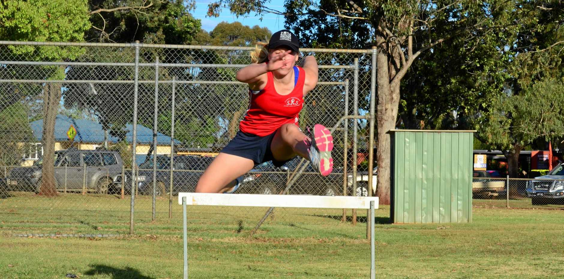 TAKING THE LEAP: Bree Pogany was just milliseconds away from a finals berth at the Queensland State Athletics Championships.
