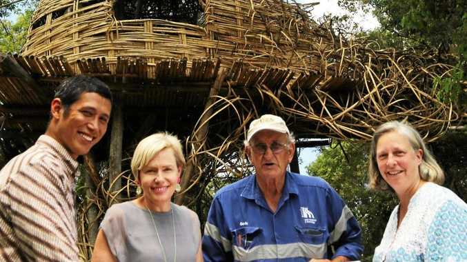 From left: Arief Rabik, Amanda Jackes, Woodfordia general manager; Gavin Kele of Arris Water and architect Nici Long of Cave Urban look over plans for the bamboo project.