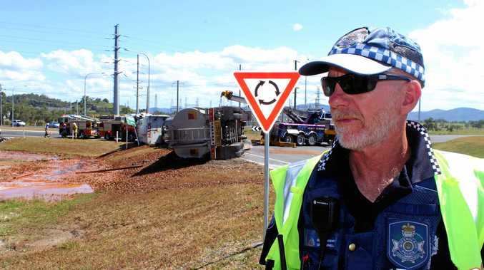 Mackay police Senior Sergeant Dave Parnell at the scene of the truck rollover at the Bruce Hwy-Hay Point Rd intersection.