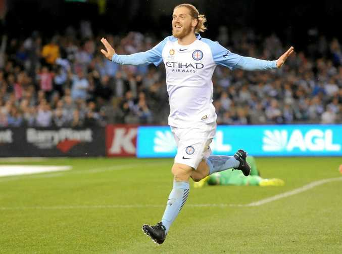 Luke Brattan of Melbourne City celebrates after scoring against the Melbourne Victory in round two of the A-League.