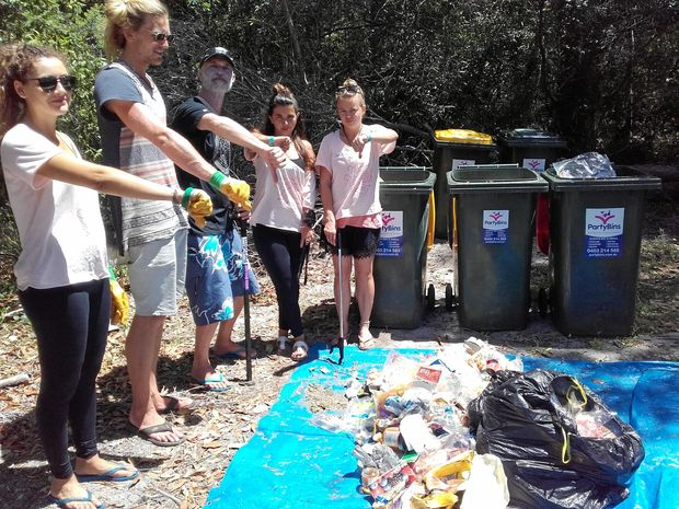 BAD RUBBISH: Climate Wave Enterprises owner Greg Howell and Wanderlust volunteers give waste the thumbs down to waste that has to go to landfill.