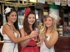 RACE DAY: Andy Chia, Sarah Wilson and Meghan Dunne preparing for last year's Melbourne Cup Day at O'Duinns.