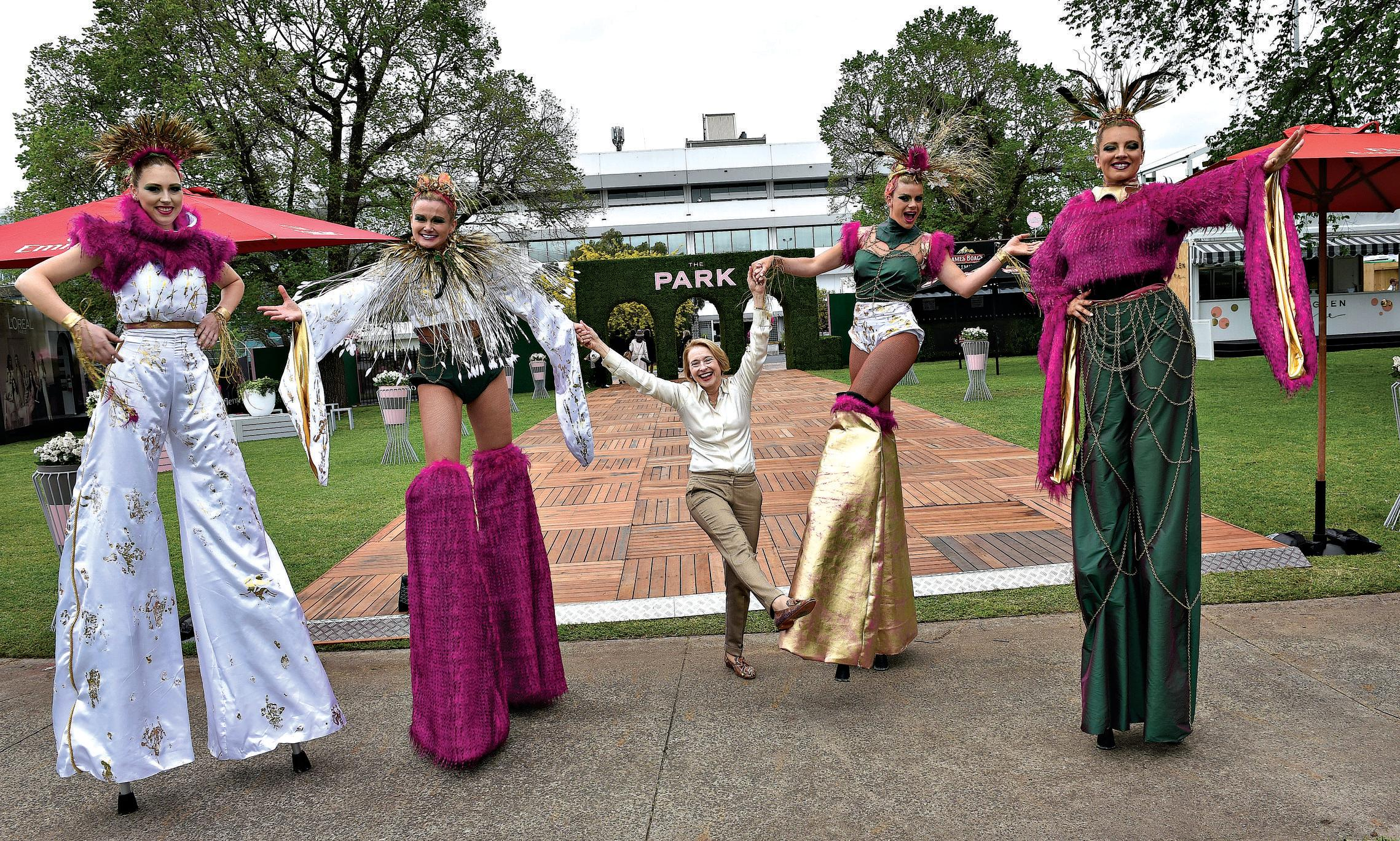 Trainer Gai Waterhouse is seen with performers at the launch of the Melbourne Cup Carnival in the The Park at Flemington racecourse in Melbourne, on October 24.