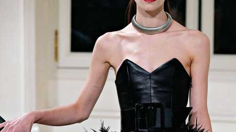 Sweet-hear necklines, like this one from the Yves Saint Laurent's Fall-Winter 2016-2017 ready to wear fashion collection, are a feminine touch for race day.