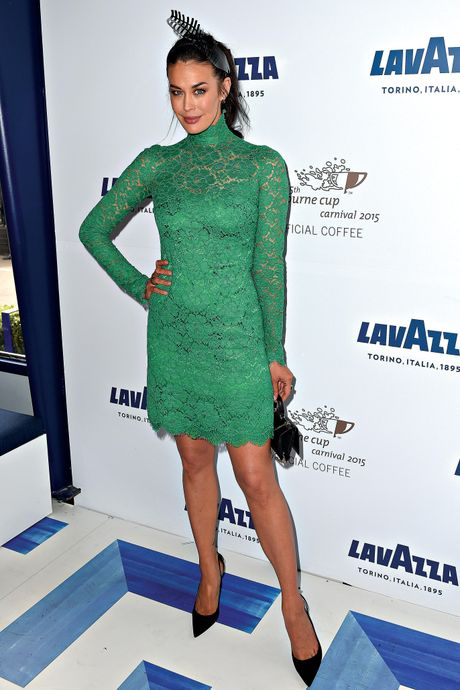 Megan Gale poses for photographs in the Lavazza marquee at the Birdcage on Melbourne Cup Day, last year.