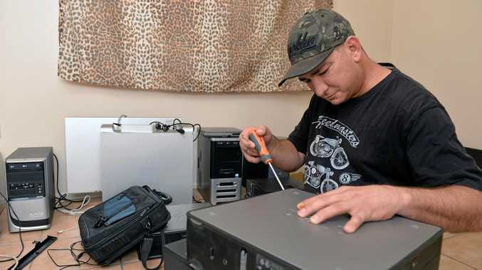 GIVING BACK: Dave Hoad is refurbishing old computers to help out families in need.