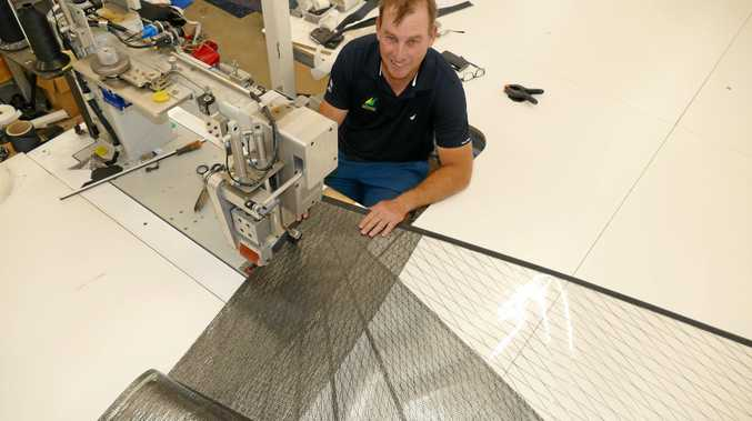 DAY JOB: At the biggest sewing machine in Australia sailor Andrew Landenberger designs and makes sails underneath his Grafton home.