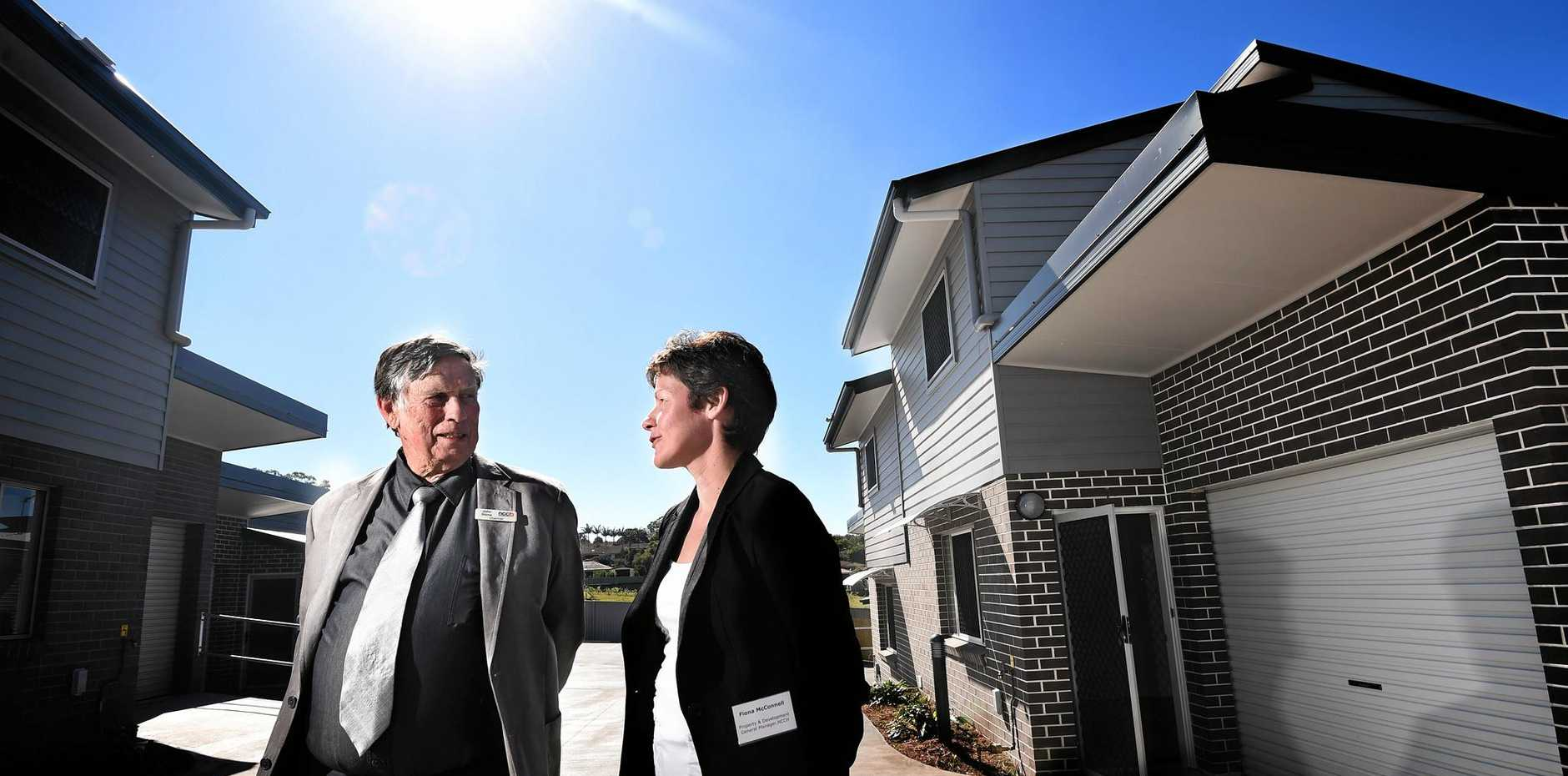 AFFORDABLE HOUSING: North Coast Community Housing's opening of Rainforest Creek was attended by NCCH Chairman John Stone and NCCH general manager Fiona McConnell.