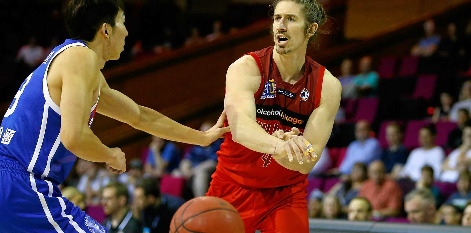 Greg Hire of the Perth Wildcats gets a pass away.