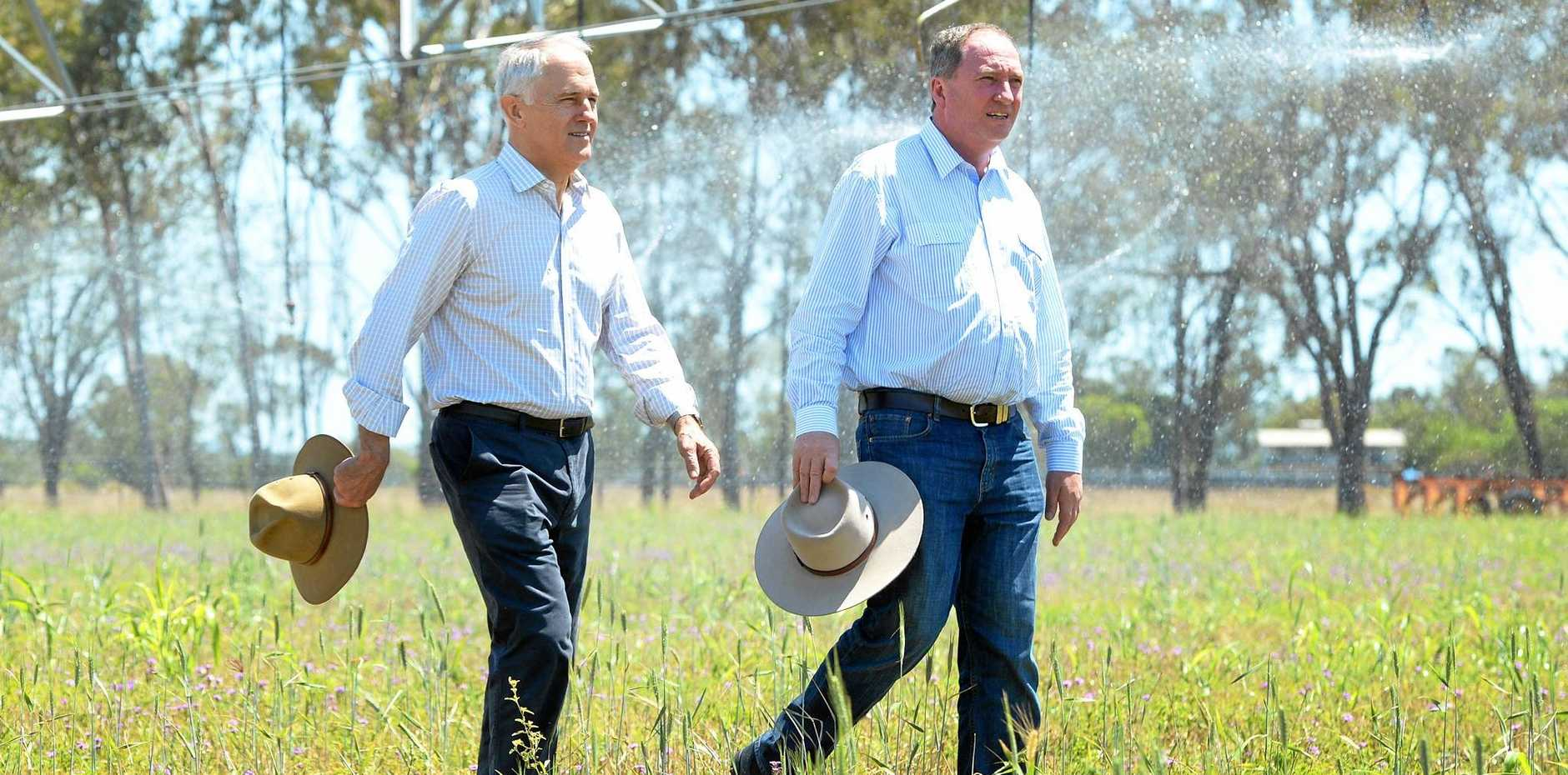 L-R Prime Minister Malcolm Turnbull and Deputy Prime Minister Barnaby Joyce tour a farm on the outskirts of Rockhampton to talk about infrastructure spending including the proposed Rookwood Weir.
