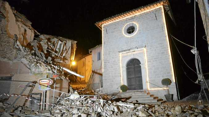 The Church of San Sebastiano stands amid damaged houses in Castelsantangelo sul Nera, Italy, following an earthquake.