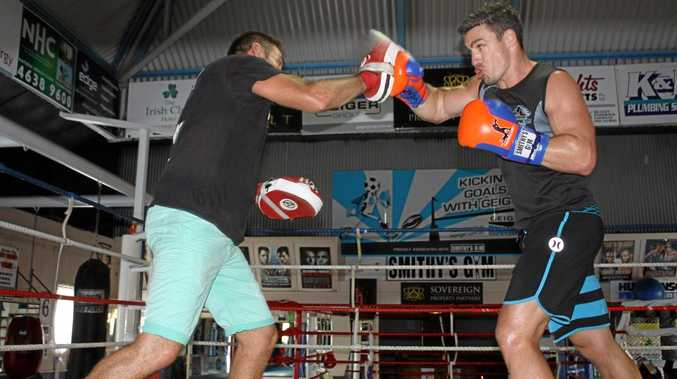 RING TIME: Former NRL player Michael Witt (right) trains with Brendon Smith last year ahead of his professional boxing debut.