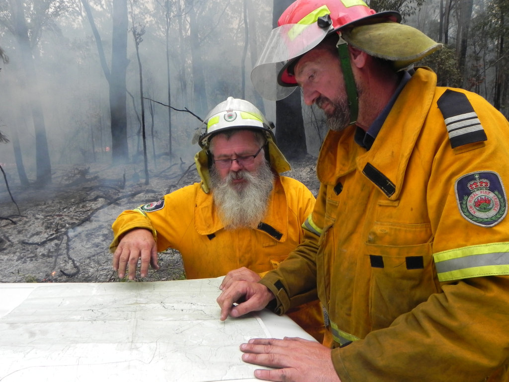 Lawrence RFS firefighter Darrell Binskin and Lawrence RFS captain Scott Campbell assess the bushfire in the Fortis Creek National Park north of Grafton on Friday, 28th October, 2016.Photo Bill North / Daily Examiner