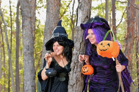 Halloween Fun: In Black Josie Laird with in purple  Shelley Strachan having some fun for Halloween. Costume courtesy of The Fancy Dress Ballroom. Photo Greg Miller / The Gympie Times
