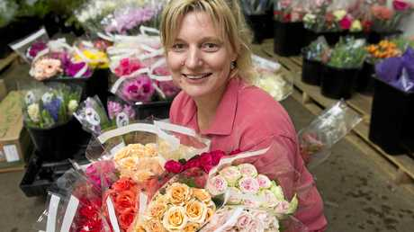 Toowoomba Flower Market owner Maree Streidl with her beautiful creations.