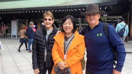 Tina and Alan Cooney with their guide in Japan.