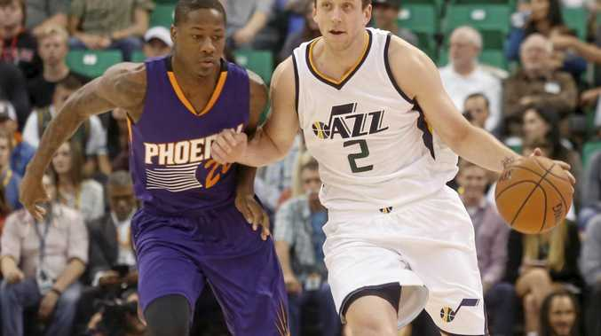Utah Jazz player Joe Ingles, from Australia, dribbles down the court as the Phoenix Suns' Archie Goodwin defends.