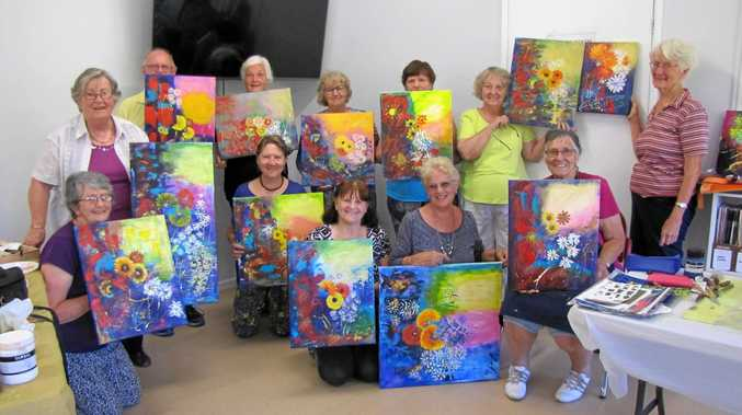 PICTURE PERFECT: Curra Art Group with their artworks.
