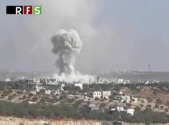 This frame grab from video provided by the Revolutionary Forces of Syria, an opposition activist media organisation, is consistent with independent AP reporting and shows an airstrike on the village of Hass, Syria. The death toll has been put at 28.