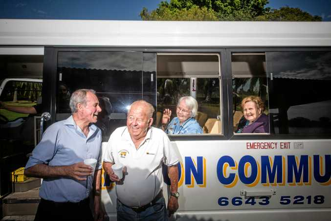 Member for Clarence Chris Gulaptis enjoys a laugh with volunteer driver and vice president of Grafton Community Bus Mick Quinn as he takes residents from St Catherines Villa, including Joan McDonald and Beryl Slade (back)