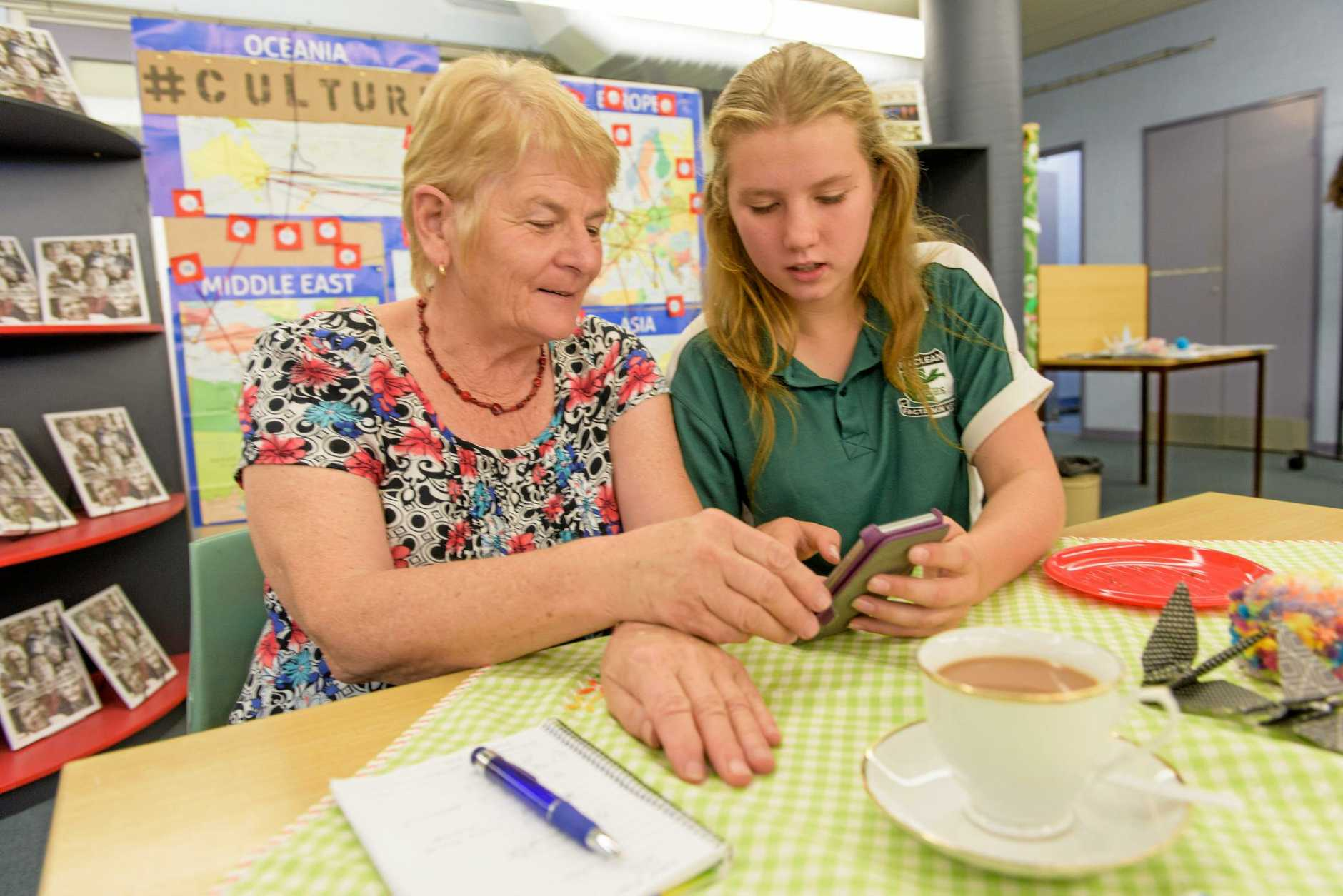 Marie Ahern gets shown the ropes of mobile technology by her granddaughter Kailah Ensbey, 13 at graandparents day at Maclean High School.