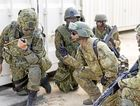 A Japanese Ground Self Defence Force soldier and an Australian Army soldier confirm their objective is secured in the Urban Operations Training Facility at the Shoalwater Bay Training Area, during Exercise Southern Jackaroo/Diamond Sprint 16.