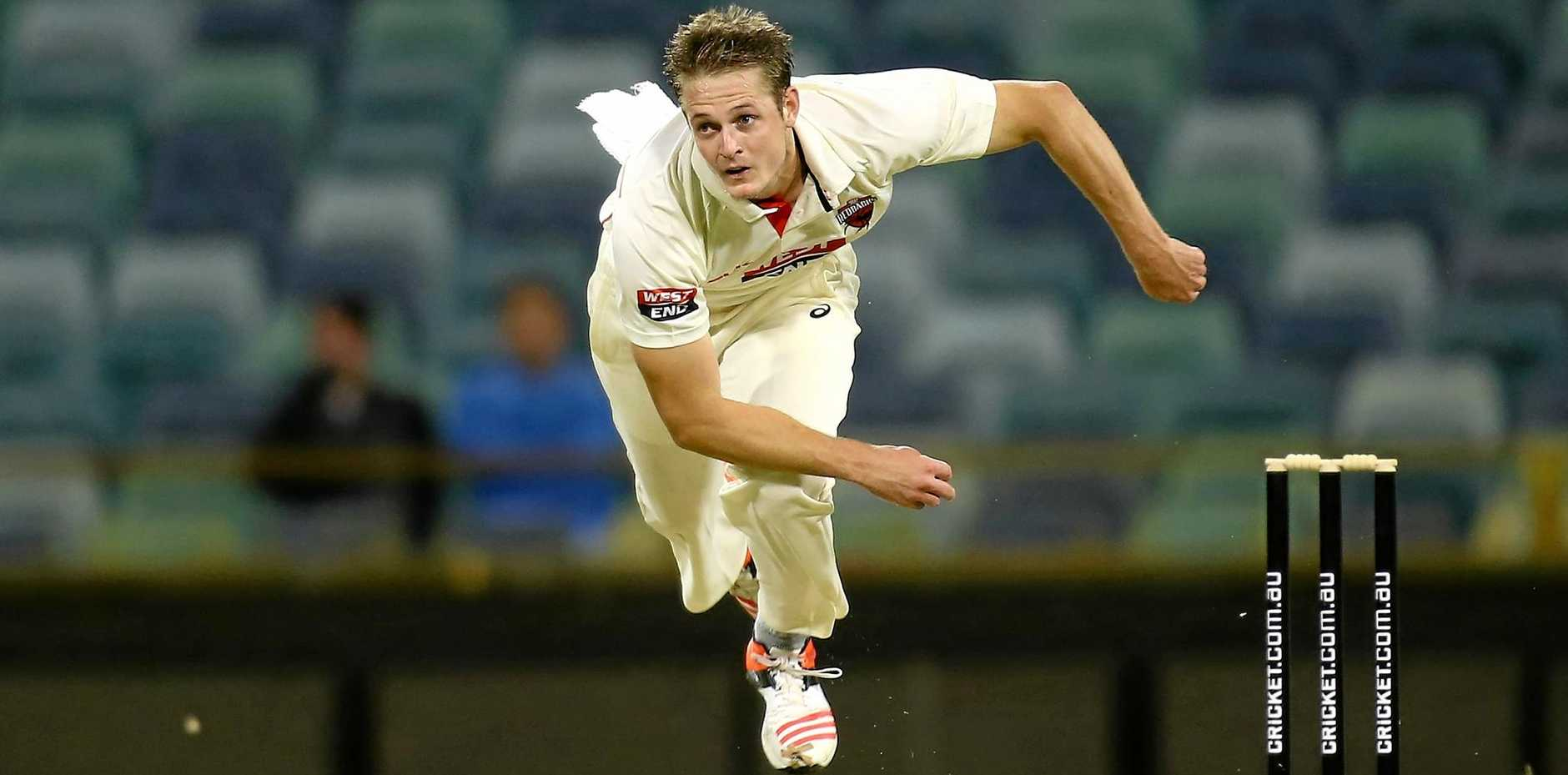 Joe Mennie of the Redbacks bowls during day one of the Sheffield Shield match against the Warriors at the WACA.