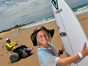 Coolum grom gives his board to surfers with disabilities