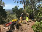 Rescue workers prepare safety ropes to aid paramedics as they help guide the injured man to safety.