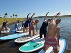 YogaFest 2016 held at the Lake Kawana Community Centre.Great balance is needed for yoga on water.