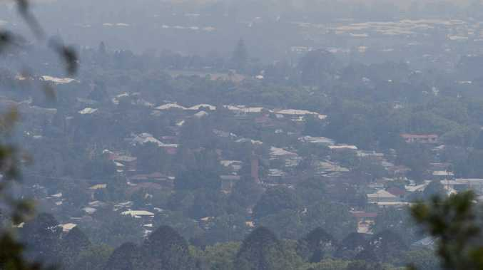 Haze blankets Toowoomba viewed from Mount Lofty lookout caused by fire at Ravensbourne, Sunday, October 30, 2016.