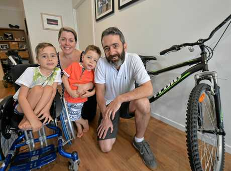 COME FORWARD: Chef Graeme 'Rozy' Mair and his sons Finley, 6, and Connor, 3, and wife Lyndsey are looking for the woman who stopped to help after a horror smash.